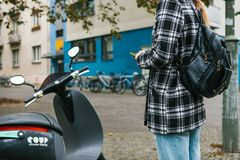 Berlin, October 1, 2017: Escooter activated through a mobile phone application. A tourist is going to use an electric Royalty Free Stock Images