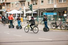 Berlin, October 3, 2017: Group of tourists riding on gyroscooters along the streets of Berlin during excursion. Cyclists. Group of tourists riding on Royalty Free Stock Photography