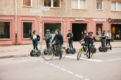 Berlin, October 3, 2017: Group of tourists riding on gyroscooters along the streets of Berlin during excursion. Cyclists. Group of tourists riding on Stock Images