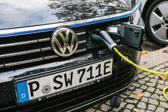 Berlin, October 2, 2017: A modern electric car is being charged at a special place for charging electric vehicles. Eco Royalty Free Stock Photography