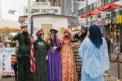 Berlin, October 1, 2017: Positive peaceful cheerful beautiful Arab women in traditional costumes communicate and take. Positive peaceful cheerful beautiful Arab Stock Photos