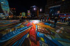 The annual Festival of lights 2018. Berlin. Germany. BERLIN - OCTOBER 07, 2018: Potsdamer Platz in brightly colored illuminations. Festival of lights 2018 royalty free stock photography