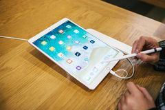 Berlin, October 2, 2017: presentation of the new advanced tablet Ipad Pro in the official Apple store. The buyer looks Stock Image