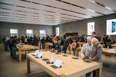 Berlin, October 2, 2017: presentation of the new advanced tablet Ipad Pro in the official Apple store. Buyers look and Royalty Free Stock Image