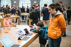 Berlin, October 2, 2017: presentation of the new advanced tablet Ipad Pro in the official Apple store. Young buyers came Stock Image