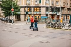 Berlin, October 3, 2017: Tourists riding on gyroscooters along the streets of Berlin during excursion. Group of tourists riding on gyroscooters along the streets Royalty Free Stock Image