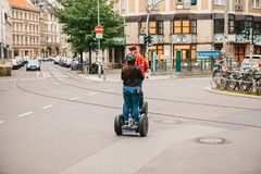Berlin, October 3, 2017: Tourists riding on gyroscooters along the streets of Berlin during excursion. Group of tourists riding on gyroscooters along the streets Stock Photos