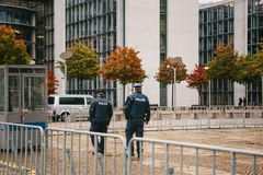 Berlin, October 2, 2017: Two policemen are patrolling. Police presence on the streets of the city. Protection of public. Police presence on the streets of the Royalty Free Stock Photography
