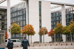 Berlin, October 2, 2017: Two policemen are patrolling. Police presence on the streets of the city. Protection of public. Police presence on the streets of the Stock Photos