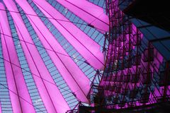 Berlin. Pink. Sony center. Potsdamer platz. Low angle view. Night. High Tech. Modern. Architecture. Construction Stock Photo