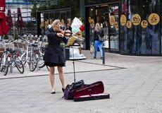 Berlin Rathausstrasse, girl playing violin Royalty Free Stock Photo