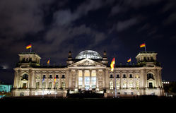 Berlin reichstag. German berlin reichstag by night with deep blue sky and some clouds Royalty Free Stock Image