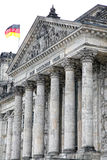 Berlin Reichstag. German parliament in Berlin with german flag Stock Image