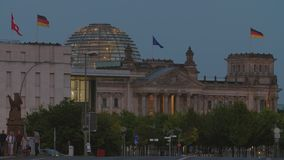 Berlin German Parliament Establishing Shot. Berlin Reichstag Building With Glass Dome. Waving German And EU Flags, People Walking, Car Drives By. Street View stock video