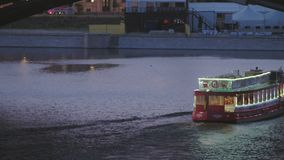 Berlin river traffic. Berlin Spree river traffic. Tourist boat floating, tilt up to railway bridge. Construction cranes and buildings landscape in the background stock footage