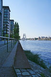 Berlin riverside path. Riverside path with railings in Berlin and distant view to the Radio Tower Stock Photo