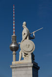 Berlin's television tower close to warriors Stock Photo