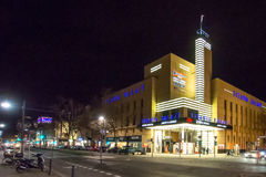 City street scene at night. Modern city street scene at night with a golden colored building and road in the foreground Stock Photography