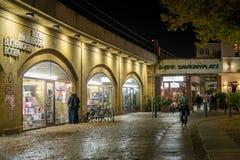 Berlin Savignyplatz at Night. Berlin's Savignyplatz square with shops and entrance to suburban rail station at night Royalty Free Stock Image