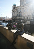 The Berlin sculptures in sun beams. Sculptures of sitting naked people Stock Image
