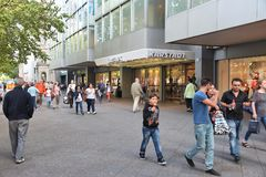 Berlin shopping. BERLIN, GERMANY - AUGUST 27, 2014: People shop at famous Kurfurstendamm (Ku'Damm) Avenue in Berlin. Berlin is Germany's largest city with Stock Image