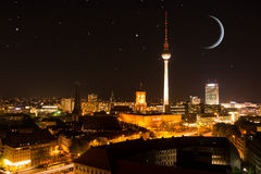 Berlin skyline with moon and stars Stock Photos