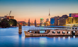 Berlin skyline with old ship wreck in Spree river at dusk, Germany Royalty Free Stock Photos