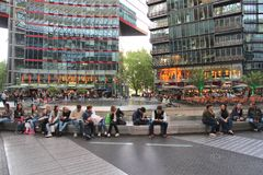 Berlin Sony Center. BERLIN, GERMANY - AUGUST 26, 2014: People visit Sony Center in Berlin. The modern complex was completed in 2000 and is Sony European royalty free stock photography