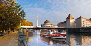 Berlin, Spree river in Autumn with touristic boat Stock Photography