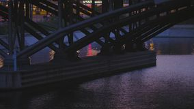 Berlin Bridge Over Water At Blue Hour. Berlin Spree River, Base Structure Of Central Station Bridge. Water, Traffic, People, Tram At Blue Hour stock footage