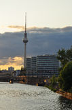 Berlin, Spree river and Fernsehturm at dusk. Germany. The Spree river in the Berlin city centre by sunset. Riverfront new urban development areas in the former Stock Photos
