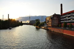 Berlin, Spree river and Fernsehturm at dusk. Germany. The Spree river in the Berlin city centre by sunset. Riverfront new urban development areas in the former Royalty Free Stock Photo