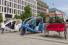 Berlin taxi bikes Stock Photos