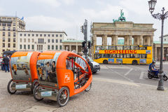 Berlin Taxi. BERLIN, GERMANY - MAY 23: Taxi bikes in front of the Brandenburger Tor on May 23, 2014 in Berlin, Germany. 5,334 kilometres of roads run through the Stock Image