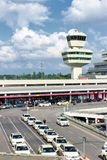 Berlin-Tegel airport tower and taxi s. BERLIN - JUN 1, 2016: Airport tower and taxi s in front of the airport terminal of Berlin-Tegel airport. This airport is Royalty Free Stock Images