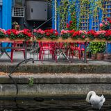 Berlin terras red chairs on the Spree river royalty free stock photos