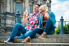 Berlin tourists enjoying view from Museum Island with beer. Tourists, women and man, enjoying the view from bridge at the Museum Island in Berlin with beer Royalty Free Stock Photos