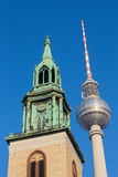Berlin - The tower of Marienkirche church and the Fernsehturm.  Royalty Free Stock Photo