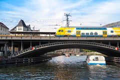 Berlin, train on iron bridge at Friedrichstrasse over river Stock Photo