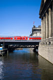 Berlin transportation. View of the suspended train in Berlin, with a part of the Pergamon museum facade on the right side Royalty Free Stock Photo
