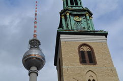 Berlin: TV tower at Alexanderplatz with church Stock Photography