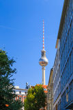 Berlin tv tower behind buildings Royalty Free Stock Image