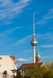 Berlin TV Tower and city neighborhood. City neighborhood, church steeple, and TV Tower (Fernsehturm) in Berlin, Germany Stock Photo