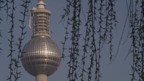 Berlin TV Tower At Daytime Through Willow. Berlin, TV Tower Street View As Seen Through Waving Willow Tree Leaves stock video