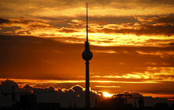 Berlin TV Tower, Fernsehturm. Beautiful Berlin skyline with focus on the magnificent Fensehturm / TV Tower against a backdrop of orange dawn sky Royalty Free Stock Photos