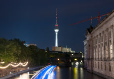 Berlin TV tower at night. The view on Berlin TV Tower at night and dancing people Royalty Free Stock Photo