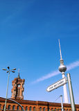 Berlin TV tower and Rotes Rathaus. Berlin TV tower on the background of blue sky, nearby is the Rotes Rathaus, lights and signs towards the street unter den Royalty Free Stock Photos