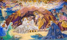 BERLIN TYSKLAND, FEBRUARI - 14, 2017: Freskomålningen av Kristi födelse i den kyrkliga Rosenkranz basilikan Arkivfoto