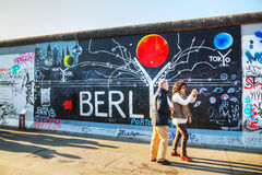 The Berlin wall (Berliner Mauer) with grafitti Stock Photography