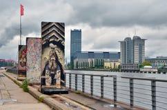 Berlin Wall (berlineren Mauer) i Tyskland Arkivfoto